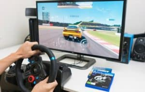 playing Gran Turismo Sport on PlayStation 4 Pro with steering wheel